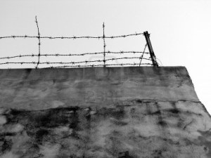 high-wall-with-iron-fence-on-it